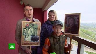 «Бессмертный полк»: нижегородцы вышли на балконы спортретами фронтовиков