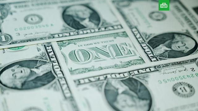 Курс доллара опустился ниже 70 рублей.Курс доллара на Московской бирже впервые за почти три месяца опустился ниже уровня в 70 рублей..доллар, евро, рубль, экономика и бизнес.НТВ.Ru: новости, видео, программы телеканала НТВ