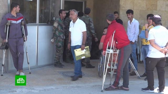 Как раненные боевиками сирийские военные восстанавливаются вгоспитале Алеппо.Сирия, армии мира, войны и вооруженные конфликты, медицина.НТВ.Ru: новости, видео, программы телеканала НТВ