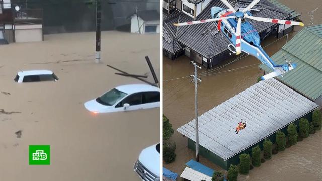 Люди на крышах просят опомощи: ливни вызвали наводнения вЯпонии иКитае.Китай, Япония, наводнения, погода.НТВ.Ru: новости, видео, программы телеканала НТВ