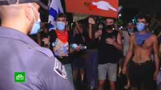 Акция протеста самозанятых в Тель-Авиве переросла в беспорядки.В Тель-Авиве акция протеста в защиту самозанятых, чей бизнес пострадал из-за коронавируса, закончилась массовыми беспорядками..Израиль, беспорядки, коронавирус, митинги и протесты, экономика и бизнес, эпидемия.НТВ.Ru: новости, видео, программы телеканала НТВ