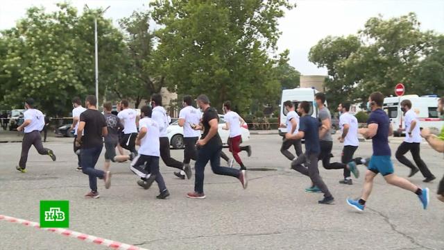 В Москве и других городах страны прошли массовые забеги.Москва, легкая атлетика, марафоны.НТВ.Ru: новости, видео, программы телеканала НТВ