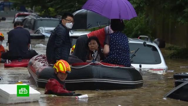 Число жертв наводнения вЮжной Корее выросло до 12человек.Южная Корея, наводнения, стихийные бедствия.НТВ.Ru: новости, видео, программы телеканала НТВ
