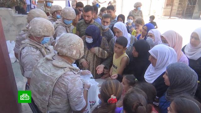 Российские военные оказывают беженцам вСирии гуманитарную имедицинскую помощь.Сирия, беженцы, войны и вооруженные конфликты.НТВ.Ru: новости, видео, программы телеканала НТВ