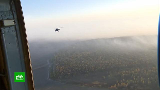 Вторые сутки борьбы согнем: на горящий арсенал под Рязанью сбросили 300тонн воды.Рязанская область, взрывы, пожары.НТВ.Ru: новости, видео, программы телеканала НТВ