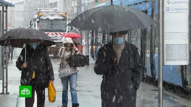 Возвращение снежной погоды застало европейцев врасплох.Бельгия, Европа, погодные аномалии, снег.НТВ.Ru: новости, видео, программы телеканала НТВ