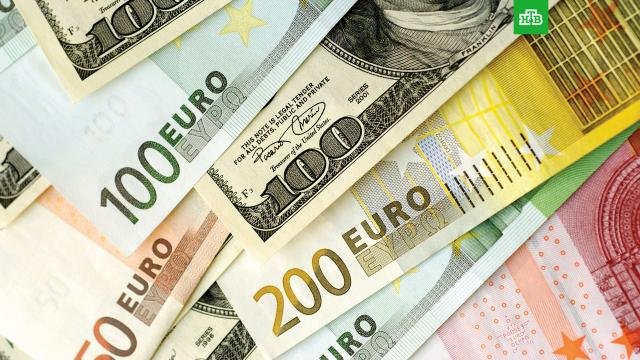 Доллар иевро резко дорожают на фоне сообщений осанкциях против госдолга РФ.США, валюта, доллар, евро, рубль, санкции.НТВ.Ru: новости, видео, программы телеканала НТВ