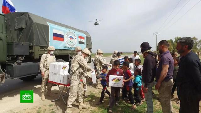 Российские военные впервые доставили гуманитарную помощь на северо-восток Сирии.Сирия, войны и вооруженные конфликты, гуманитарная помощь.НТВ.Ru: новости, видео, программы телеканала НТВ