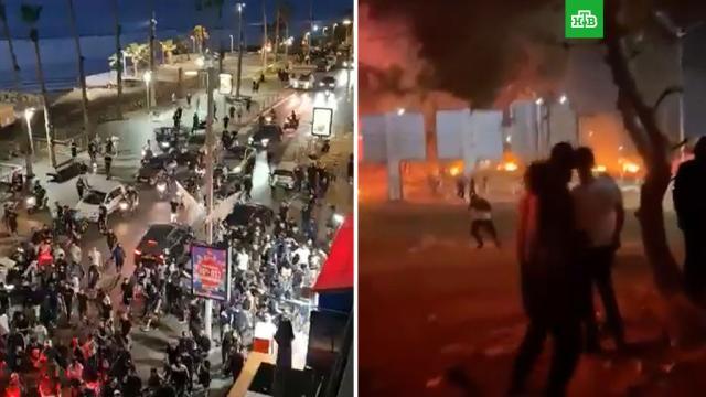 Ожесточенные столкновения на улицах израильских городов не стихают иночью.Израиль, Палестина, ХАМАС, армии мира, войны и вооруженные конфликты.НТВ.Ru: новости, видео, программы телеканала НТВ