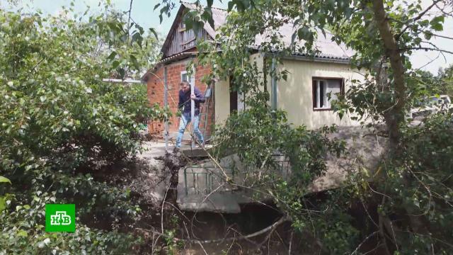 В Адыгее разливающаяся горная река угрожает жилым домам.Адыгея, жилье, реки и озера.НТВ.Ru: новости, видео, программы телеканала НТВ