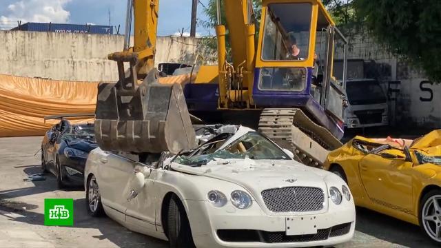На Филиппинах устроили публичную казнь дорогих автомобилей.Филиппины, автомобили.НТВ.Ru: новости, видео, программы телеканала НТВ