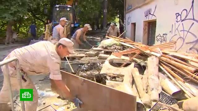 Пострадавшие от наводнения крымчане получают компенсации за испорченное имущество.Крым, наводнения, стихийные бедствия.НТВ.Ru: новости, видео, программы телеканала НТВ
