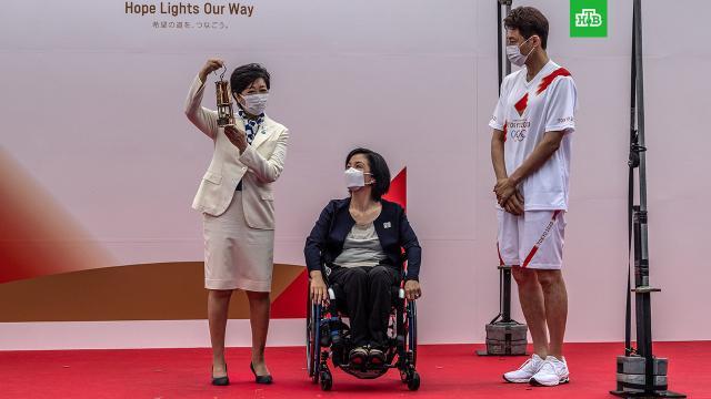 ВТокио доставили олимпийский огонь.Олимпиада, Токио, Япония, коронавирус.НТВ.Ru: новости, видео, программы телеканала НТВ