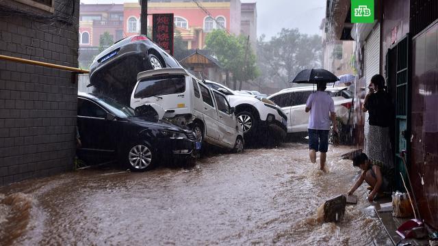 Число жертв наводнения в Китае выросло до 25.Китай, наводнения, стихийные бедствия.НТВ.Ru: новости, видео, программы телеканала НТВ