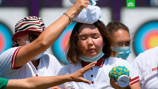 Российская лучница потеряла сознание на Олимпиаде в Токио.Светлана Гомбоева потеряла сознание во время выступления на Олимпиаде в Токио.Олимпиада, Токио, Япония.НТВ.Ru: новости, видео, программы телеканала НТВ