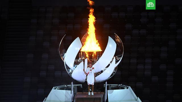 В Токио зажгли огонь летних Олимпийских игр.Огонь XXXII летних Олимпийских игр зажжен в Токио.Олимпиада, Токио, Япония, спорт.НТВ.Ru: новости, видео, программы телеканала НТВ