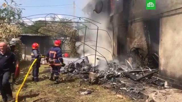 На Украине легкомоторный самолет упал на жилой дом: четверо погибли.Украина, авиационные катастрофы и происшествия, самолеты.НТВ.Ru: новости, видео, программы телеканала НТВ