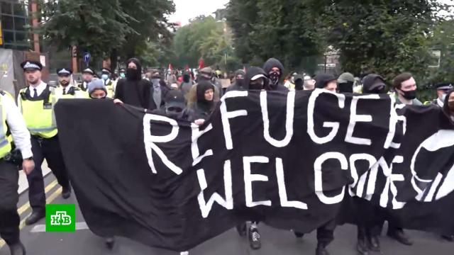 Сторонники и противники приема афганских беженцев схлестнулись на митинге в Лондоне.Афганистан, Великобритания, Лондон, беженцы, беспорядки, митинги и протесты.НТВ.Ru: новости, видео, программы телеканала НТВ