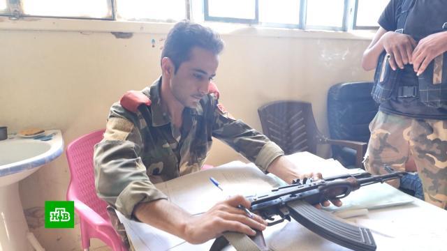 ВСирии открыли полицейский участок для решивших разоружиться радикалов.Сирия, войны и вооруженные конфликты.НТВ.Ru: новости, видео, программы телеканала НТВ